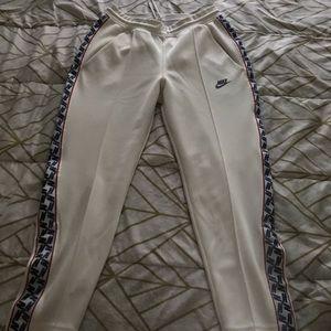 White Nike track pants